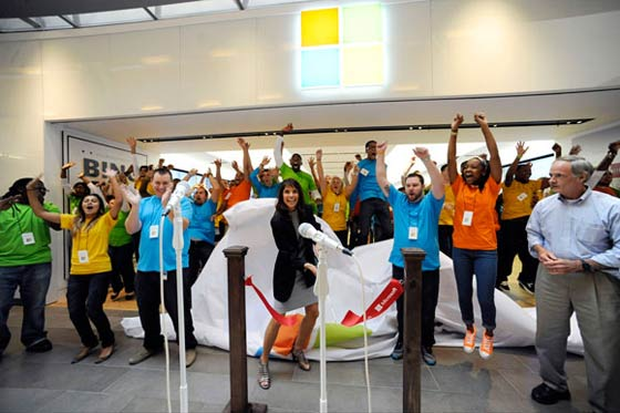 Microsoft employees excited and enthusiastic at the opening of a store location in the UK, via hexus.net